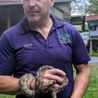 derek holding a snake